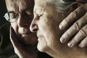 Portrait of senior couple with closed eyes, close-up.